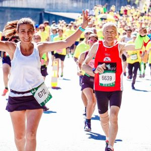 Female And Male Runners On A Marathon 2402777