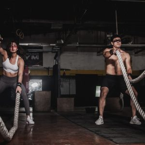 Man And Woman Holding Battle Ropes 1552242